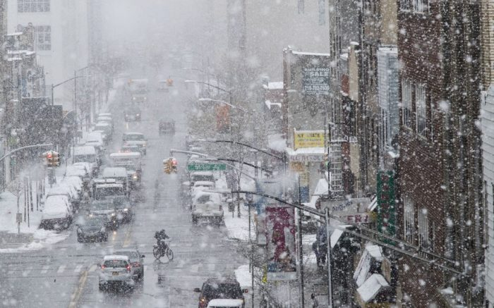 Traffic makes it's way along Flushing Avenue in a snow storm, Wednesday, March 21, 2018, in the Brooklyn borough of New York. A spring nor'easter targeted the Northeast on Wednesday with strong winds and a foot or more of snow expected in some parts of the region. (AP Photo/Mary Altaffer)