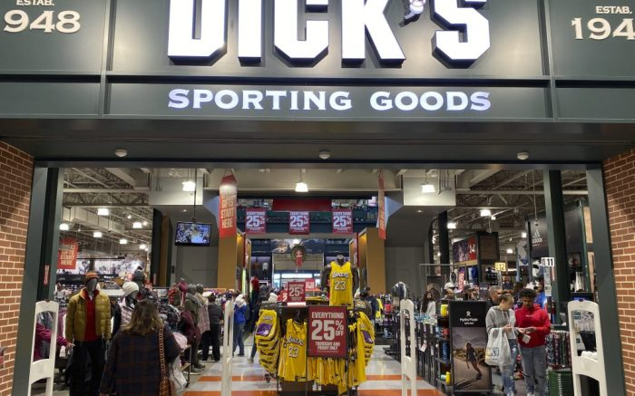 General overall view of 25 percent off sale signs at Dick's Sporting Goods store at the Los Cerritos Center, Friday, Nov. 29, 2019, in Cerritos, Calif. (Kirby Lee via AP)