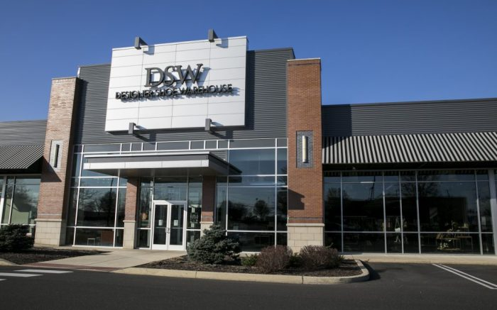 A logo sign outside of a Designer Shoe Warehouse (DSW) retail store location in North Wales, Pennsylvania, on March 23, 2020. (Photo by Kristoffer Tripplaar/Sipa USA)(Sipa via AP Images)