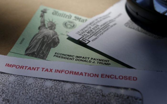 President Donald Trump's name is seen on a stimulus check issued by the IRS to help combat the adverse economic effects of the COVID-19 outbreak, in San Antonio, Thursday, April 23, 2020. According to the Treasury Department, it marks the first time a president's name has appeared on any IRS payments, whether refund checks or other stimulus checks that have been mailed during past economic crises. (AP Photo/Eric Gay)