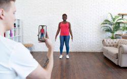 Woman having photo taken by friend