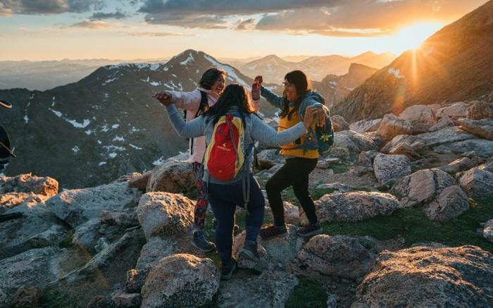 Women Dancing on Mountain Summit to