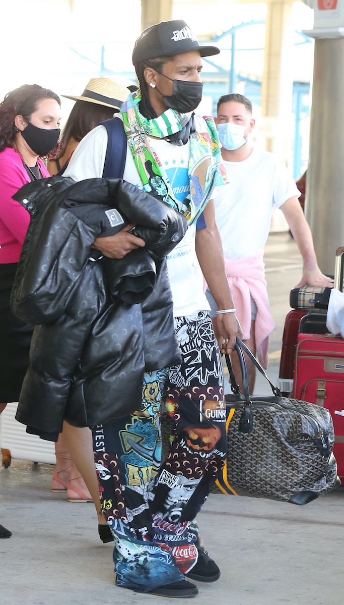 """EXCLUSIVE: Rapper ASAP Rocky arrives in Barbados to spend Christmas with new love Rihanna. The """"Everyday"""" rapper arrived in the Caribbean island on a commercial flight, a week after Rihanna arrived to spend the festive period in her home nation via private jet. The """"Umbrella"""" singer is staying at her secluded private villa on the island's west coast. """"They've been inseparable the past few weeks,"""" a source told US magazine People. """"It's a new relationship, but they both seem very into it."""" Rocky and Rihanna, both 32, have been friends for years. He opened for the US dates of Rihanna's Diamonds World Tour back in 2013. The couple first sparked romance rumors after Rihana split from her boyfriend of three years, billionaire Hassan Jameel, in January. The previous month, they posed together on the red carpet at the Fashion Awards at the Royal Albert Hall in London. The couple later celebrated New Year's Eve together at the Edition Hotel in New York City. The following month, the Fenty Beauty founder supported Rocky (real name Rakim Mayers) at his Yams Day Benefit concert in Brooklyn, where she was also seen hanging out with her ex-boyfriend Drake. In July, Rihanna featured Rocky in her Fenty Skin campaign. The duo did several interviews together to promote the collaboration. Rocky's late father is actually from Barbados and he still has family living on the Caribbean island. The rapper has previously dated celebrities such as Kendall Jenner in 2017 and Brazilian model Daiane Sodré last year. 22 Dec 2020 Pictured: ASAP Rocky. Photo credit: Natasha/MEGA TheMegaAgency.com +1 888 505 6342 (Mega Agency TagID: MEGA722582_001.jpg) [Photo via Mega Agency]"""