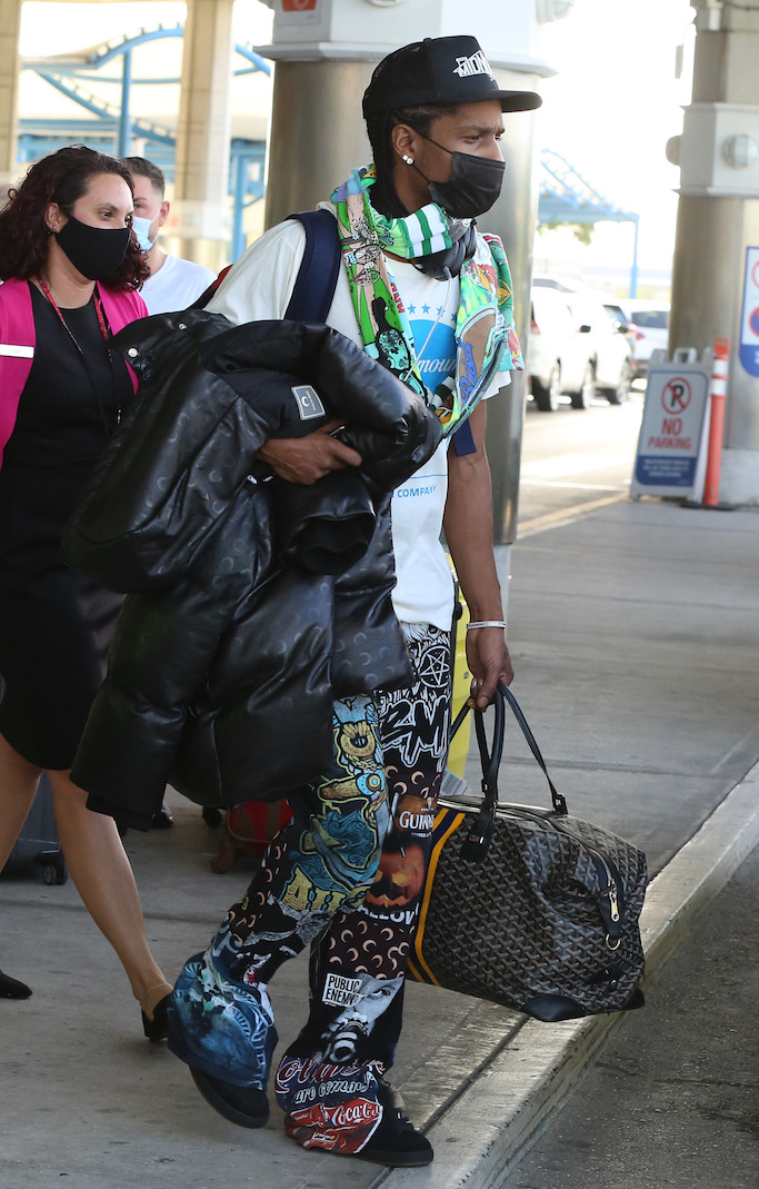 """EXCLUSIVE: Rapper ASAP Rocky arrives in Barbados to spend Christmas with new love Rihanna. The """"Everyday"""" rapper arrived in the Caribbean island on a commercial flight, a week after Rihanna arrived to spend the festive period in her home nation via private jet. The """"Umbrella"""" singer is staying at her secluded private villa on the island's west coast. """"They've been inseparable the past few weeks,"""" a source told US magazine People. """"It's a new relationship, but they both seem very into it."""" Rocky and Rihanna, both 32, have been friends for years. He opened for the US dates of Rihanna's Diamonds World Tour back in 2013. The couple first sparked romance rumors after Rihana split from her boyfriend of three years, billionaire Hassan Jameel, in January. The previous month, they posed together on the red carpet at the Fashion Awards at the Royal Albert Hall in London. The couple later celebrated New Year's Eve together at the Edition Hotel in New York City. The following month, the Fenty Beauty founder supported Rocky (real name Rakim Mayers) at his Yams Day Benefit concert in Brooklyn, where she was also seen hanging out with her ex-boyfriend Drake. In July, Rihanna featured Rocky in her Fenty Skin campaign. The duo did several interviews together to promote the collaboration. Rocky's late father is actually from Barbados and he still has family living on the Caribbean island. The rapper has previously dated celebrities such as Kendall Jenner in 2017 and Brazilian model Daiane Sodré last year. 22 Dec 2020 Pictured: ASAP Rocky. Photo credit: Natasha/MEGA TheMegaAgency.com +1 888 505 6342 (Mega Agency TagID: MEGA722582_005.jpg) [Photo via Mega Agency]"""