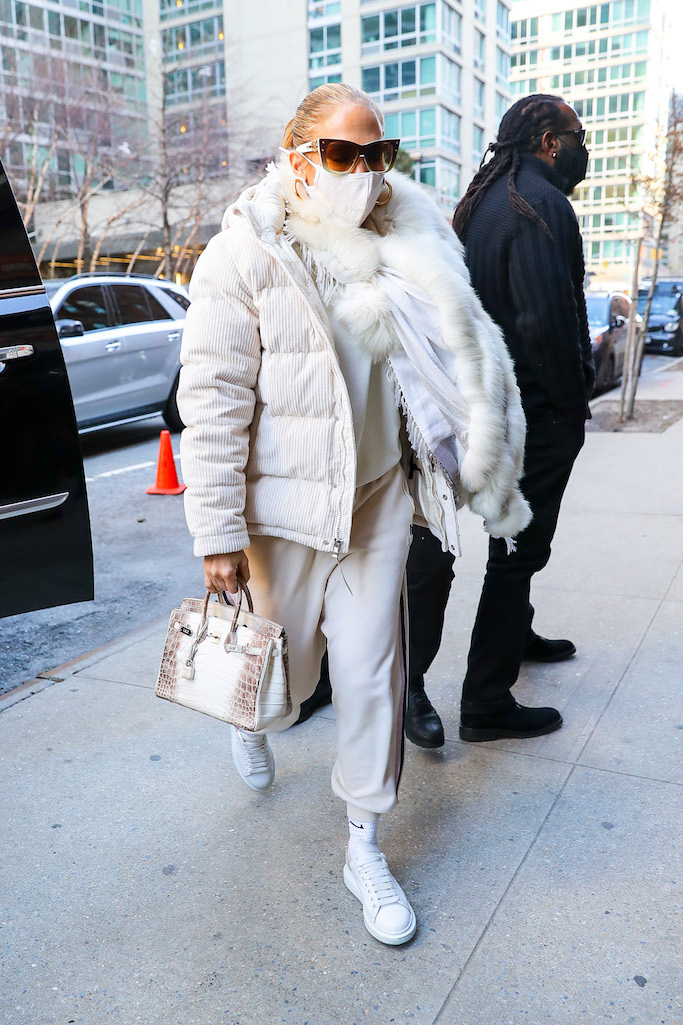 Jennifer Lopez is dressed in an all-white ensemble, even her Hermes handbag is white, as she heads into rehearsals for New Year's Rockin' Eve in Times Square.Pictured: Jennifer Lopez Ref: SPL5204675 291220 NON-EXCLUSIVE Picture by: Felipe Ramales / SplashNews.com Splash News and Pictures USA: +1 310-525-5808 London: +44 (0)20 8126 1009 Berlin: +49 175 3764 166 photodesk@splashnews.com World Rights