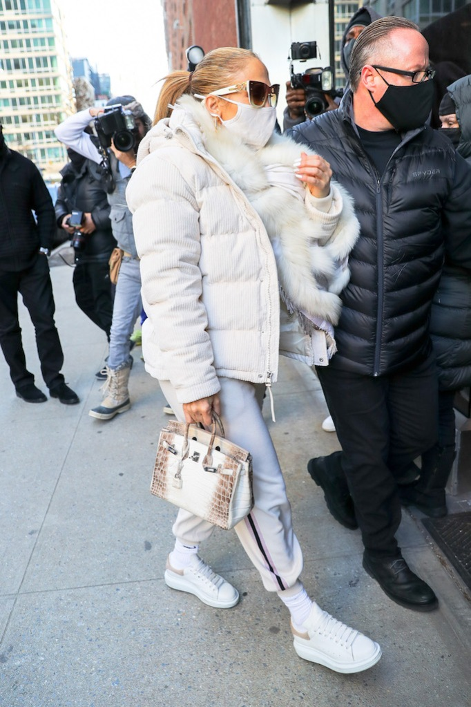 Jennifer Lopez is dressed in an all-white ensemble, even her Hermes handbag is white, as she heads into rehearsals for New Year's Rockin' Eve in Times Square.Pictured: Jennifer LopezRef: SPL5204675 291220 NON-EXCLUSIVEPicture by: Felipe Ramales / SplashNews.comSplash News and PicturesUSA: +1 310-525-5808London: +44 (0)20 8126 1009Berlin: +49 175 3764 166photodesk@splashnews.comWorld Rights
