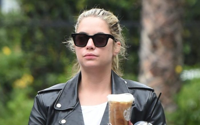 EXCLUSIVE: Ashley Benson sports a black leather jacket as she grabs her morning coffee to go