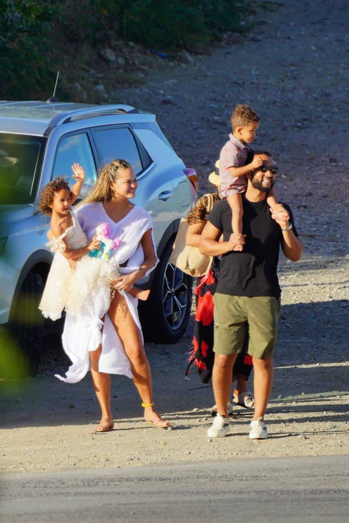 John Legend and Chrissy Teigen show the extreme landing in St Barts airport to their kids. St Barts is well known to be one of the most dangerous airports in the world to land. 25 Dec 2020 Pictured: John Legend and Chrissy Teigen. Photo credit: EliotPress/MEGA TheMegaAgency.com +1 888 505 6342 (Mega Agency TagID: MEGA722971_001.jpg) [Photo via Mega Agency]