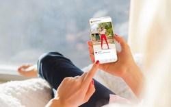 Woman looking at photo sharing app