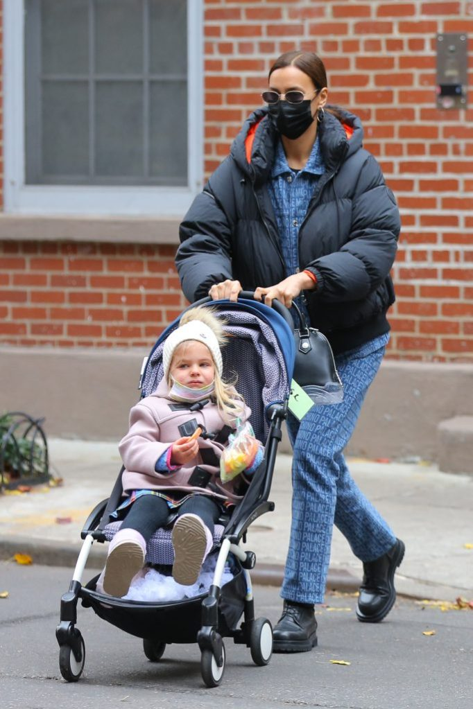 Russian model Irina Shayk and her daughter Lea Cooper walk home in West Village in New York City. Irina is wearing a blue denim jumpsuit by Moschino.Pictured: Lea Cooper,Irina ShaykRef: SPL5201026 021220 NON-EXCLUSIVEPicture by: Christopher Peterson / SplashNews.comSplash News and PicturesUSA: +1 310-525-5808London: +44 (0)20 8126 1009Berlin: +49 175 3764 166photodesk@splashnews.comWorld Rights