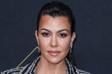 Kourtney Kardashian Styles a Ruby-Red Romper With Metallic Prada Slides on an Italian Getaway