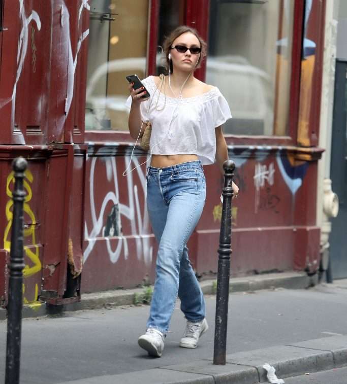 EXCLUSIVE: Lily-Rose Depp steps out in Paris wearing jeans and a white crop top ahead of dad Johnny's High Court libel action which is due to start tomorrow (Tuesday) in London. The King actress, 21, has been quarantining in Paris with her mother Vanessa Paradis. Depp, 57, and ex-Amber Heard, 34, Could come face-to-face during the trial, which is scheduled to last three weeks. The Pirates of the Caribbean star's legal team has tried to stop Heard from giving evidence in his libel action against her. A newspaper referred to Depp as a 'wife beater', which he strenuously denies. Depp's lawyer, Eleanor Laws QC, had argued that Heard's evidence could be less reliable if she were present during Depp's testimony. She also claimed that actress was not a 'party' in the litigation and therefore did not have to be in court before appearing as a witness. But Mr Justice Nicol has refused to grant Depp's request, clearing the way for Heard to attend the trial. It is not known exactly who will attend. 06 Jul 2020 Pictured: Lily Rose Depp. Photo credit: Paname Press / MEGA TheMegaAgency.com +1 888 505 6342 (Mega Agency TagID: MEGA686914_009.jpg) [Photo via Mega Agency]