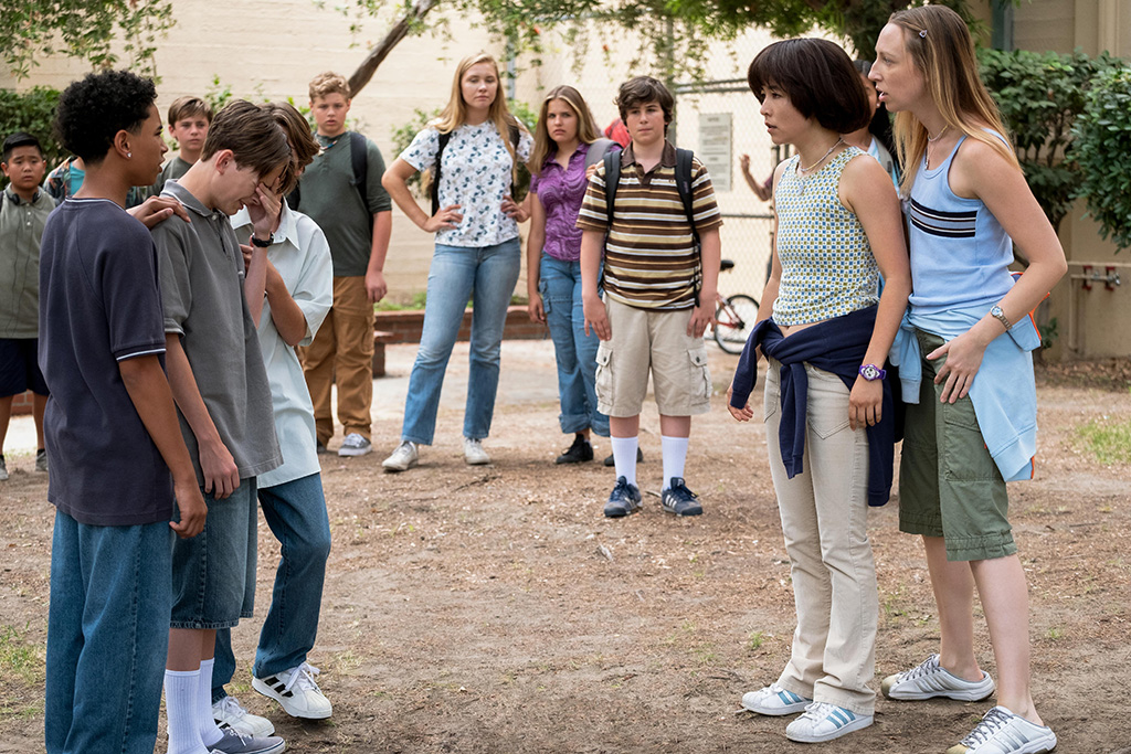 """PEN15 -- """"First Day"""" - Episode 101 - It's the first day of seventh grade in the year 2000. School rejects, Anna and Maya, get a lot of unexpected attention. Dustin (Isaac Edwards), Brandt (Jonah Beres), Alex (Lincoln Jolly), Sam (Taj Cross), Maya Ishii-Peters (Maya Erskine), and Anna Kone (Anna Konkle), shown. (Photo by: Alex Lombardi/Hulu)"""