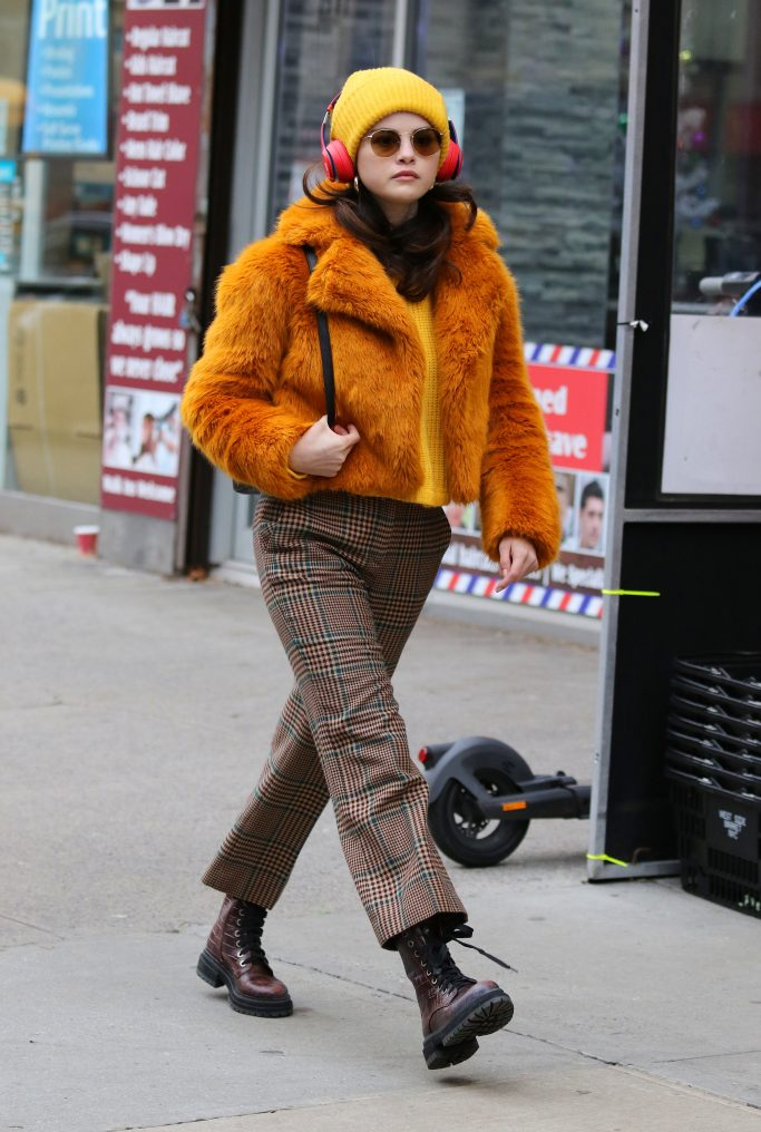 """Selena Gomez sports a colorful wardrobe on the set of """"Murders in the Building"""" filming in Manhattan. Selena was seen wearing sunglasses and beats headphones in stylish colorful clothes. 07 Dec 2020 Pictured: Selena Gomez. Photo credit: LRNYC / MEGA TheMegaAgency.com +1 888 505 6342 (Mega Agency TagID: MEGA719748_003.jpg) [Photo via Mega Agency]"""