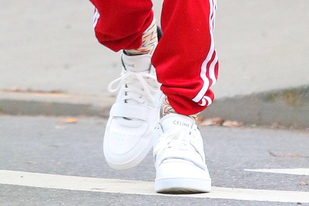 timothée chalamet, red pants, sneakers, prada jacket, green jacket, street style, music, new york