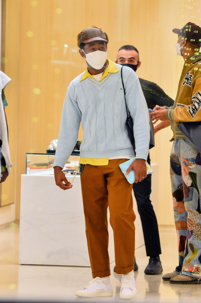 EXCLUSIVE: Tyler the Creator buys himself a 3,750$ purse at Botega Veneta while shopping with friends on Rodeo Drive. 26 Dec 2020 Pictured: Tyler the Creator. Photo credit: Snorlax / MEGA TheMegaAgency.com +1 888 505 6342 (Mega Agency TagID: MEGA723087_015.jpg) [Photo via Mega Agency]