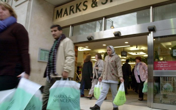 Shoppers come and go from the Marks and Spencer store on London's Oxford Street, Tuesday Nov. 6, 2001. British retailer Marks & Spencer PLC announced Tuesday a 20 percent rise in profits for the first half of the year, rising to 220.3 million pounds ($ 321.4 million) from 183.4 million ($267.6 million) for the same period last year, but it acknowledged that it still faced an uncertain future. (AP Photo/Richard Lewis)
