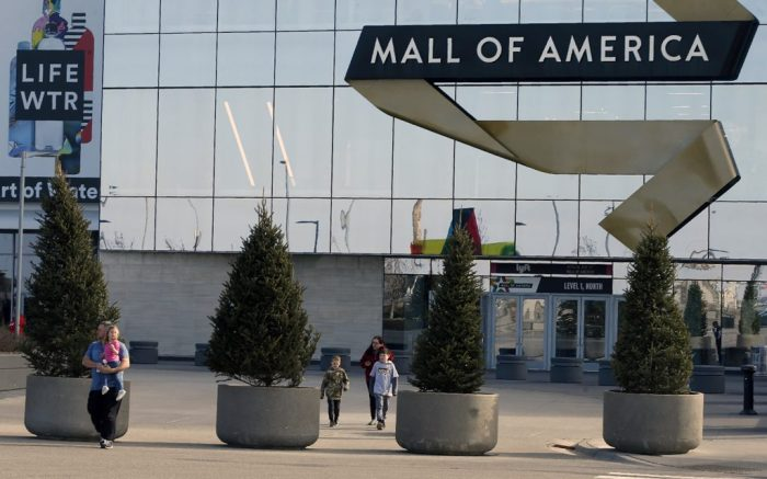 Shoppers, visitors and employees leave the Mall of America Tuesday, March 17, 2020 as the mall in Bloomington, Minn. moments before it closed temporarily through at least March 31 in an effort to limit the spread of the coronavirus. (AP Photo/Jim Mone)