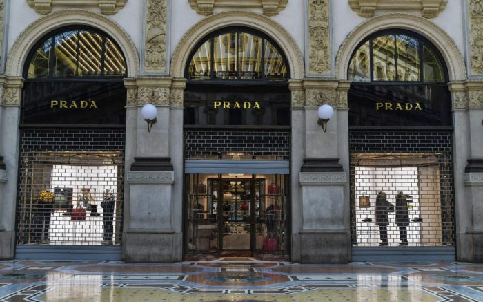 Prada store is shut down, at the Vittorio Emanuele shopping arcade in Milan, Italy, Friday, Nov. 6, 2020. Lombardy is among the four Italian regions classified as red zones, where a strict lockdown was imposed starting Friday - to be reassessed in two weeks - in an effort to curb the COVID-19 infections growing curve. Starting today, only shops selling food and other essentials are allowed to open. (Gian Mattia D'Alberto/LaPresse via AP)