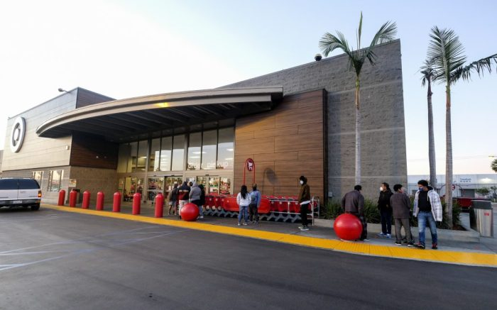 A few Black Friday shoppers wait in line to enter a Target store that opened at 7am in Commerce, Calif., Friday, Nov. 27, 2020. (AP Photo/Ringo H.W. Chiu)