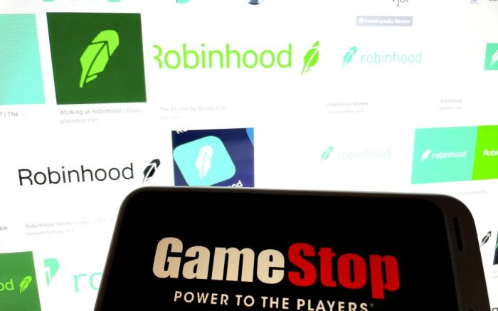 Photo by: STRF/STAR MAX/IPx 2021 1/29/21 Robinhood lifts restrictions on trading GameStop and raises $1 Billion. GameStop shares rose as much as 100% in pre-market trading. STAR MAX Photo: Robinhood and GameStop logos photographed off Apple devices.