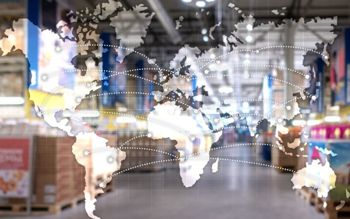 Graphic of a world map laid over fulfillment warehouse