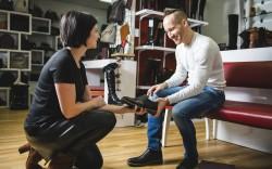 Female sales associate helping a man