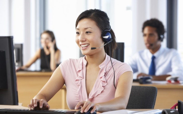 Woman working at a call center providing customer support