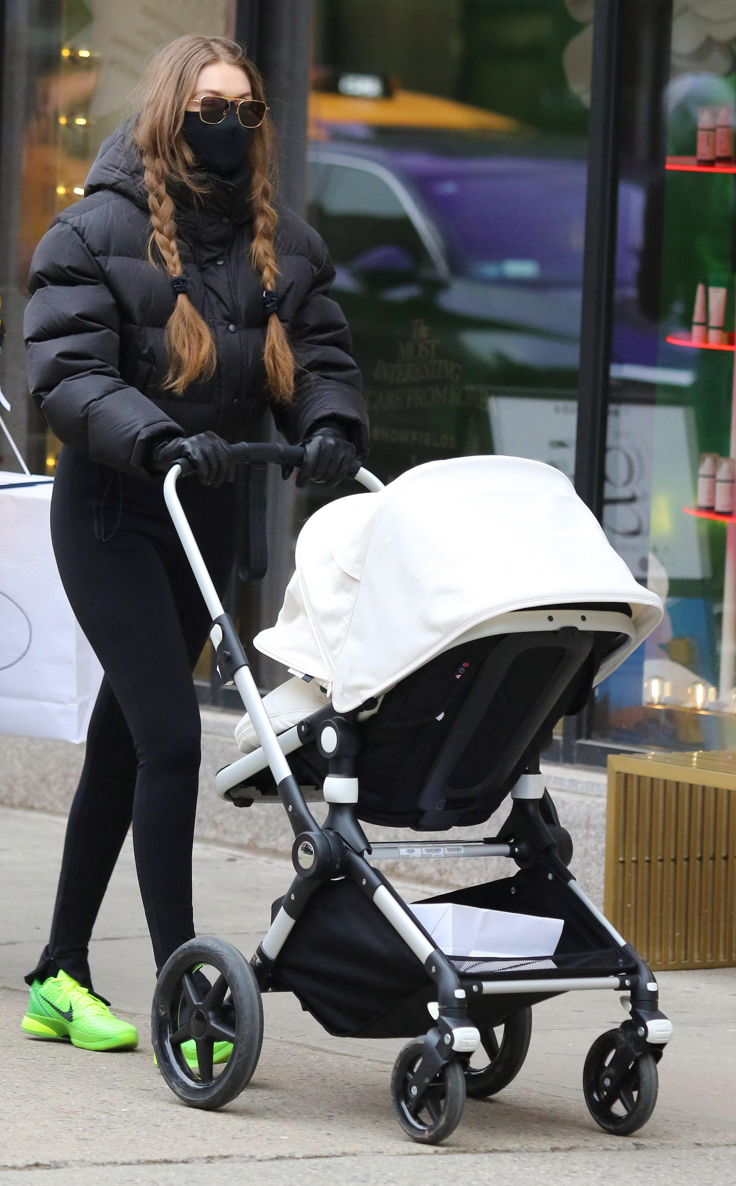Gigi Hadid wears spandex and a puffy jacket while out with baby daughter around Manhattan's Soho area. 11 Jan 2021 Pictured: Gigi Hadid. Photo credit: LRNYC / MEGA TheMegaAgency.com +1 888 505 6342 (Mega Agency TagID: MEGA725870_002.jpg) [Photo via Mega Agency]