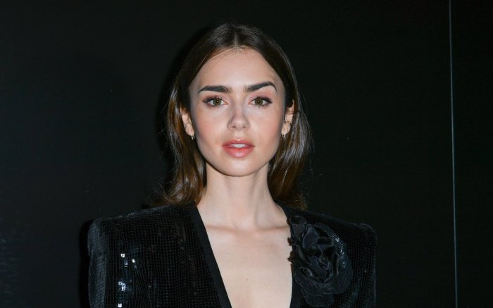 Lily Collins attends the Saint Laurent show as part of the Paris Fashion Week Womenswear Fall/Winter 2020/2021
