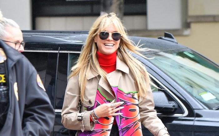 Heidi Klum heads into America's got Talent filming wearing a coat with Graffiti on it