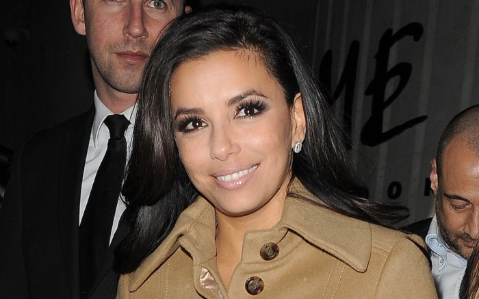 Eva Longoria out and about in London, having attended the Global Gift Gala. The actress wore a tan coloured coat over the top of her elaborate looking dress