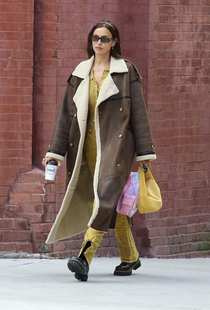 Irina Shayk looks stylish with a yellow outfit and a large brown coat while on a coffee run in Manhattan's West Village area. 22 Jan 2021 Pictured: Irina Shayk. Photo credit: LRNYC / MEGA TheMegaAgency.com +1 888 505 6342 (Mega Agency TagID: MEGA728349_001.jpg) [Photo via Mega Agency]