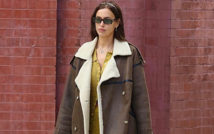 Irina Shayk looks stylish with a yellow outfit and a large brown coat while on a coffee run in NYC