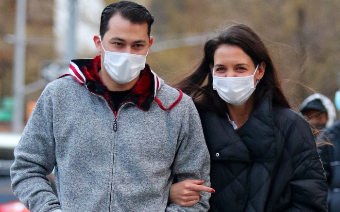A very happy Katie Holmes is all smiles with her boyfriend Emilio Vitolo Jr. during a romantic stroll in NYC