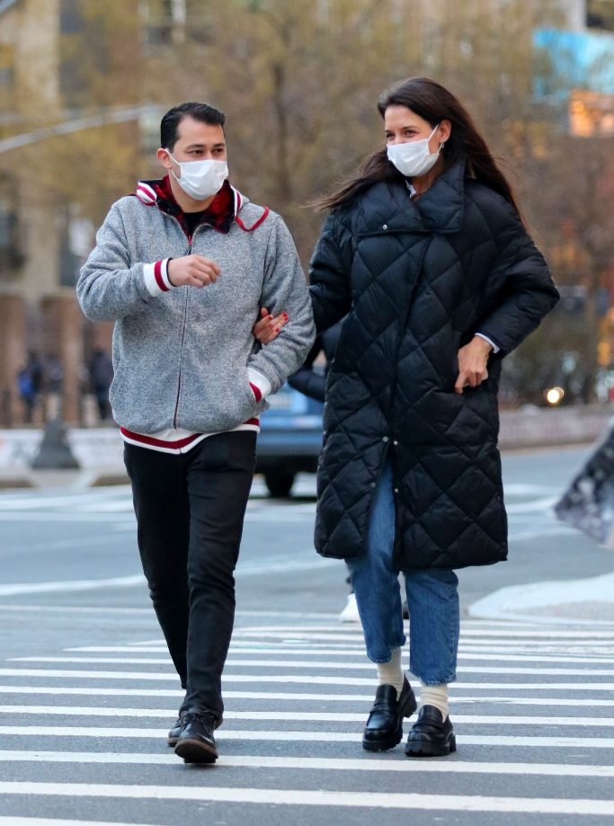 A very happy Katie Holmes is all smiles with her boyfriend Emilio Vitolo Jr. during a romantic stroll in Manhattan's Soho neighborhood. 22 Jan 2021 Pictured: Katie Holmes and Emilio Vitolo Jr. Photo credit: LRNYC / MEGA TheMegaAgency.com +1 888 505 6342 (Mega Agency TagID: MEGA728438_002.jpg) [Photo via Mega Agency]