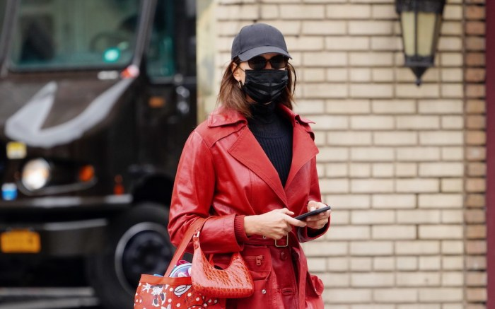 Irina Shayk out and about in a leather trench in New York
