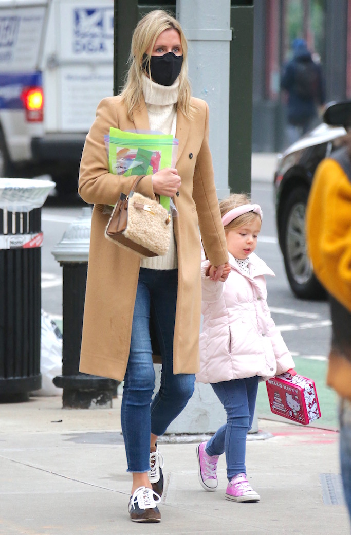 Nicky Hilton is walking back home with her daughter in Soho, New York, NY on January 15, 2021.Photo by Dylan Travis/ABACAPRESS.COM Pictured: Nicky Hilton Ref: SPL5206842 150121 NON-EXCLUSIVE Picture by: AbacaPress / SplashNews.com Splash News and Pictures USA: +1 310-525-5808 London: +44 (0)20 8126 1009 Berlin: +49 175 3764 166 photodesk@splashnews.com United Arab Emirates Rights, Australia Rights, Bahrain Rights, Canada Rights, Finland Rights, Greece Rights, India Rights, Israel Rights, South Korea Rights, New Zealand Rights, Qatar Rights, Saudi Arabia Rights, Singapore Rights, Thailand Rights, Taiwan Rights, United Kingdom Rights, United States of America Rights