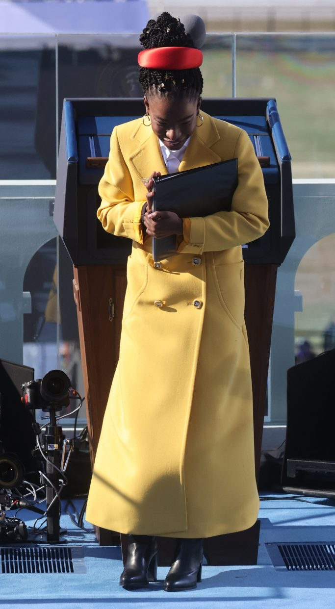 Amanda Gorman walks after she recited a poem during the inauguration of Joe Biden as the 46th President of the United States on the West Front of the U.S. Capitol in Washington, Wednesday, Jan. 20, 2021. (Jonathan Ernst/Pool Photo via AP)