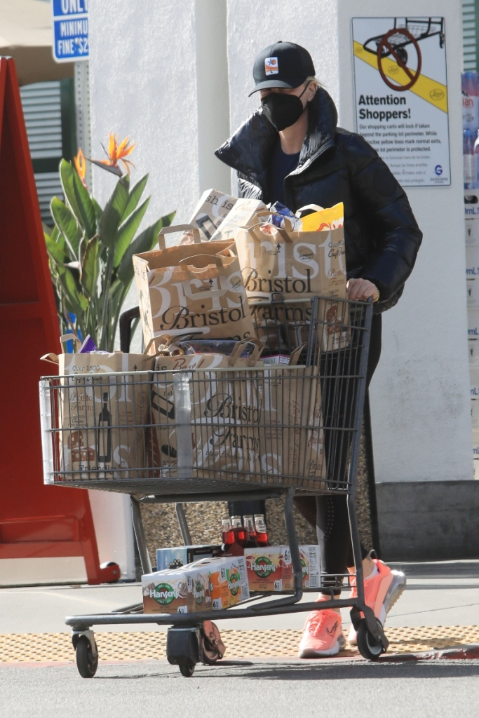 charlize theron, leggings, sneakers, coat, sneakers, puffer, shop, store, los angeles