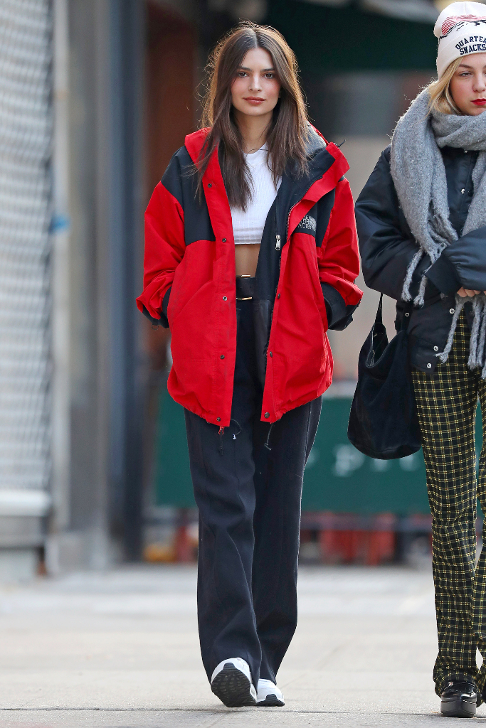 Emily Ratajkowski, The North Face red jacket, black pants, sneakers