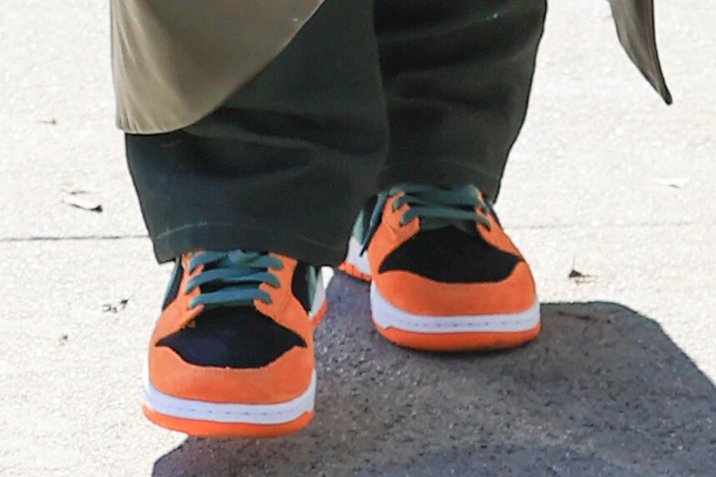 hailey baldwin, pants, coat, jacket, leather, green, sneakers, nike, orange, black, los angeles