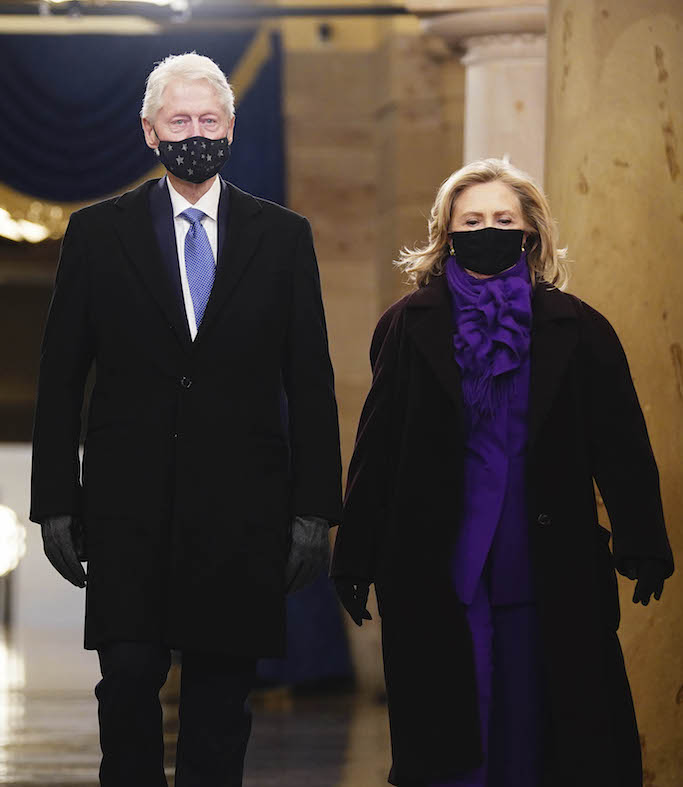 purple suit, purple outfit, Former President Bill Clinton, left, and former Secretary of State Hillary Clinton arrive in the Crypt of the US Capitol for President-elect Joe Biden's inauguration ceremony on Wednesday, Jan. 20, 2021 in Washington. (Jim Lo Scalzo (Jim Lo Scalzo/Pool Photo via AP)