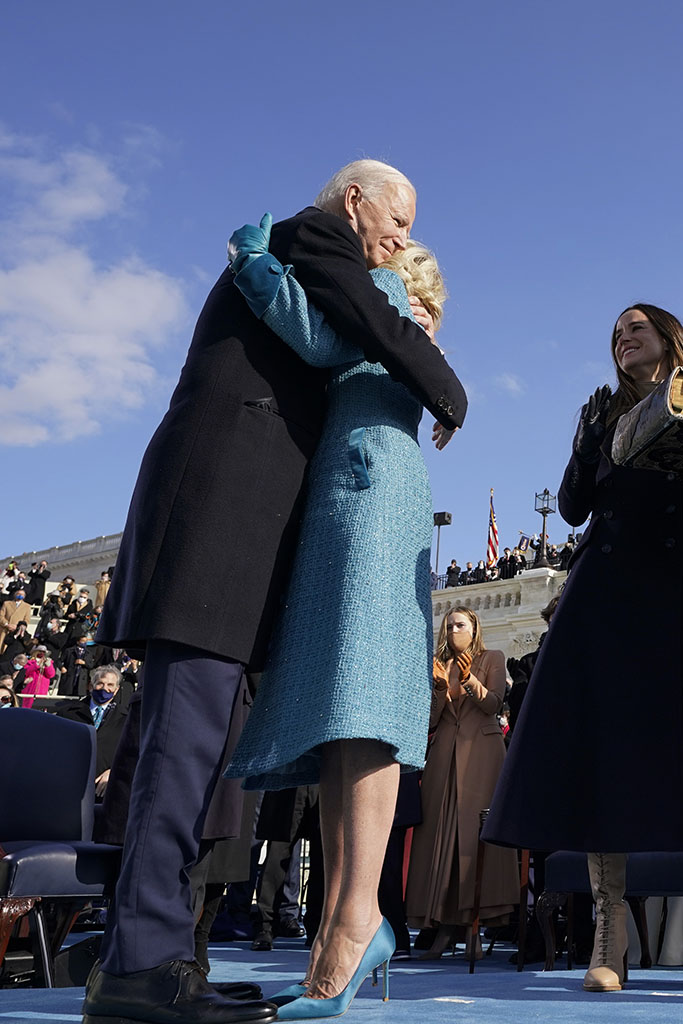 President Joe Biden hugs first lady Jill Biden, as his son Hunter Biden and daughter Ashley Biden look on after he was sworn-in during the 59th Presidential Inauguration at the U.S. Capitol in Washington, Wednesday, Jan. 20, 2021. Vice President Kamala Harris applauds at right. (AP Photo/Andrew Harnik, Pool)