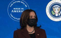 Vice President Kamala Harris listens as