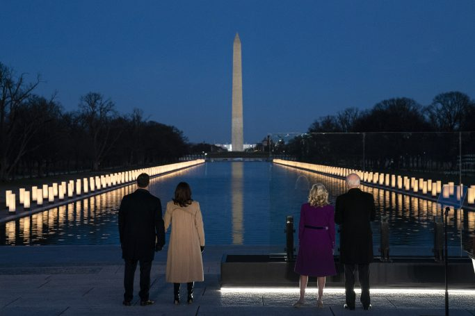 President-elect Joe Biden and his wife Jill Biden are joined by Vice President-elect Kamala Harris and her husband Doug Emhoff to participate in an COVID-19 memorial event at the Lincoln Memorial Reflecting Pool, Tuesday, Jan. 19, 2021, in Washington. (AP Photo/Evan Vucci)
