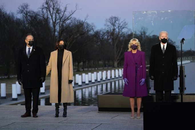 President-elect Joe Biden and his wife Jill, along with Vice President-elect Kamala Harris and her husband Doug Emhoff, listen as Cardinal Wilton Gregory, Archbishop of Washington, delivers the invocation during a COVID-19 memorial, with lights placed around the Lincoln Memorial Reflecting Pool, Tuesday, Jan. 19, 2021, in Washington. (AP Photo/Alex Brandon)