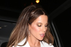 Kate Beckinsale Preps Her Skinny Jeans & Platform Boots for Winter in a Neon Puffer — And Matching Pink Coats for Her Pets, Too