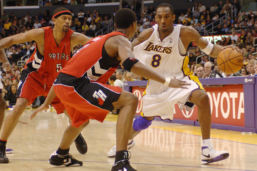 Los Angeles Lakers Kobe Bryant (8) drive past Toronto Raptors' Jalen Rose, left, and Chris Both in the fourth quarter of a NBA basketball game Sunday, Jan. 22, 2006, in Los Angeles (AP Photo/Matt A. Brown)