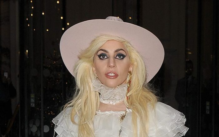 Lady Gaga arrives at Tape Nightclub in Mayfair to play a secret gig for fans. She wore a pink cowboy hat and a cream lace dress for the occasion, and was carrying her own guitar.